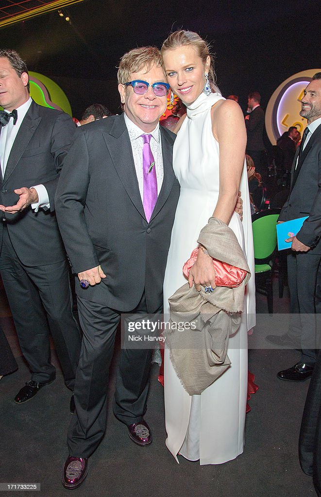 Sir Elton John and Eva Herzigova attend the 15th Annual White Tie and Tiara Ball to Benefit Elton John AIDS Foundation in Association with Chopard at Woodside on June 27, 2013 in Windsor, England. No sales to online/digital media worldwide until the 14th of July. No sales before July 14th, 2013 in UK, Spain, Switzerland, Mexico, Dubai, Russia, Serbia, Bulgaria, Turkey, Argentina, Chile, Peru, Ecuador, Colombia, Venezuela, Puerto Rico, Dominican Republic, Greece, Canada, Thailand, Indonesia, Morocco, Malaysia, India, Pakistan, Nigeria. All pictures are for editorial use only and mention of 'Chopard' and 'The Elton John Aids Foundation' are compulsory. No sales ever to Ok, Now, Closer, Reveal, Heat, Look or Grazia magazines in the United Kingdom. No sales ever to any jewellers or watchmakers other than Chopard.