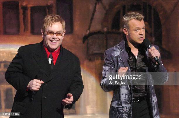Sir Elton John and Graham Norton during The Royal Variety Concert Inside and Show at The Coliseum in London Great Britain