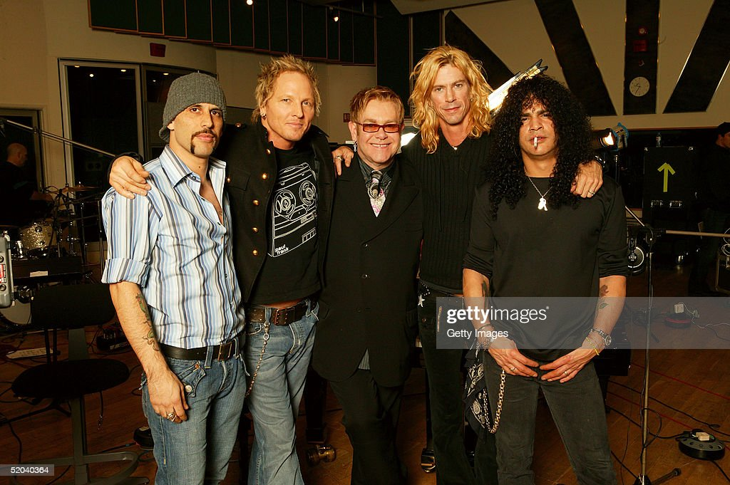 Sir Elton John (centre) and members of Velvet Revolver (L-R) guitarist Dave Kushner, drummer Matt Sorum, bassist Duff McKagan and guitarist Slash record the charity cover of Eric Clapton's 'Tears In Heaven' Tsunami Relief Single at Whitfield Studios on January 20, 2005 in London. Other stars to contribute to the single will include Robbie Williams, Rod Stewart, Pink, Ozzy and Kelly Osbourne, Andrea Bocelli, Gwen Stefani, Gavin Rossdale, Robert Downey Jr., Phil Collins, Josh Groban and Aerosmith's Steve Tyler. The single is an initiative of Sharon Osbourne, and proceeds will go to benefit aid organization Save the Children's operations in tsunami-affected regions.