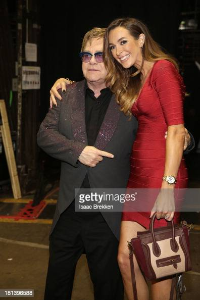Sir Elton John and Producer Courtney Bingham attend the iHeartRadio Music Festival at the MGM Grand Garden Arena on September 20 2013 in Las Vegas...