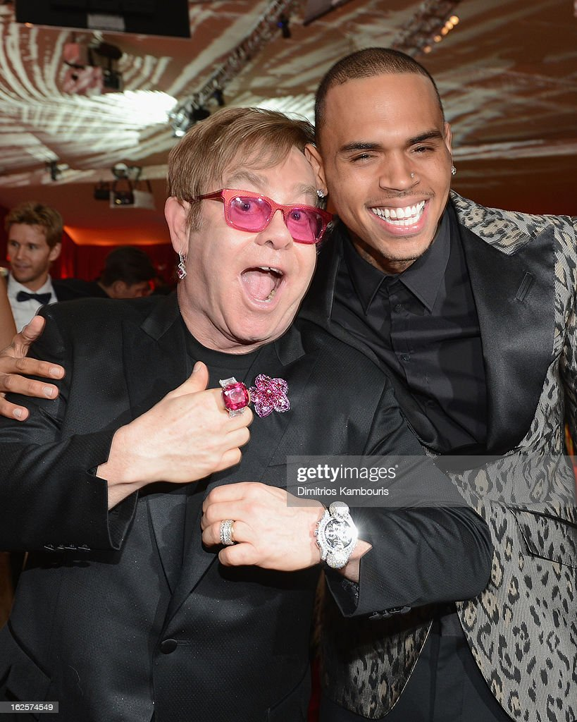 Sir Elton John and singer Chris Brown attend the 21st Annual Elton John AIDS Foundation Academy Awards Viewing Party at West Hollywood Park on February 24, 2013 in West Hollywood, California.