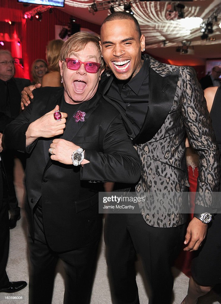 Sir Elton John and singer Chris Brown attends the 21st Annual Elton John AIDS Foundation Academy Awards Viewing Party at West Hollywood Park on February 24, 2013 in West Hollywood, California.