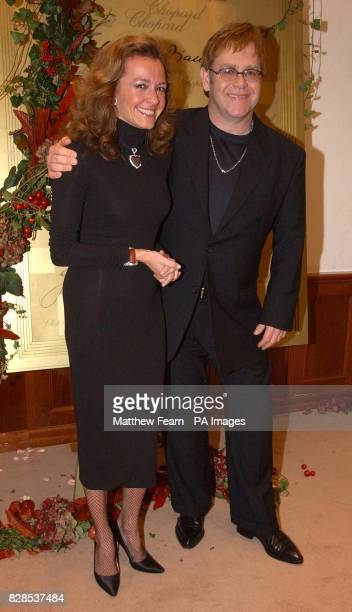 Sir Elton John and vice president of Chopard Caroline GruosiScheufele during the opening of the new Chopard boutique in London's New Bond Street *...