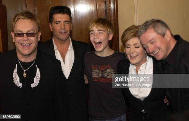 Sir Elton John left takes the curtain call alongside original Billy Elliot actor Liam Mower centre and X Factor judges Simon Cowell Sharon Osbourne...