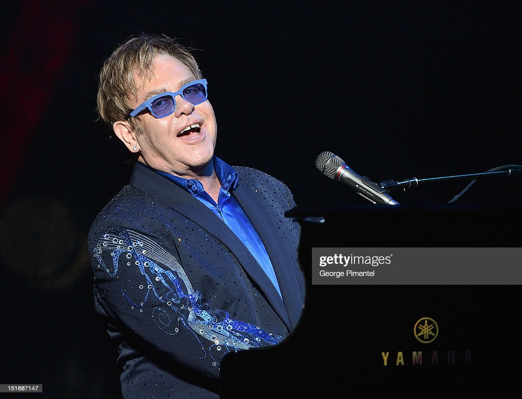 Sir <a gi-track='captionPersonalityLinkClicked' href=/galleries/search?phrase=Elton+John&family=editorial&specificpeople=171369 ng-click='$event.stopPropagation()'>Elton John</a> performs during Fashion Cares: A Night Of Glitter & Light Featuring <a gi-track='captionPersonalityLinkClicked' href=/galleries/search?phrase=Elton+John&family=editorial&specificpeople=171369 ng-click='$event.stopPropagation()'>Elton John</a> at Sony Centre For Performing Arts on September 9, 2012 in Toronto, Canada.