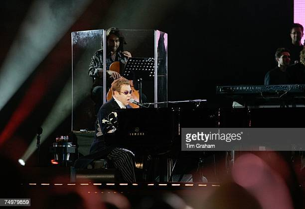 Sir Elton John performs on stage at the 'Concert for Diana' at Wembley Stadium which the Princes organised to celebrate the life of their mother...