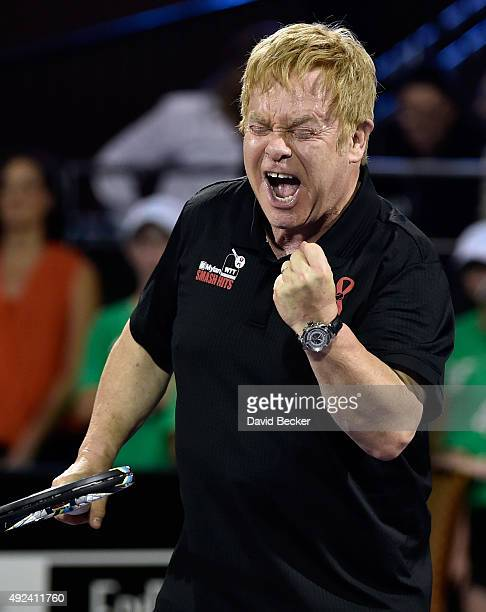 Sir Elton John reacts after scoring a point while playing at the Mylan World TeamTennis Smash Hits charity tennis event at Caesars Palace on October...