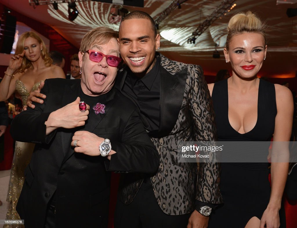 Sir Elton John, singer Chris Brown and Chairman and Founder of Neuro Diana Jenkins attend the 21st Annual Elton John AIDS Foundation Academy Awards Viewing Party at West Hollywood Park on February 24, 2013 in West Hollywood, California.