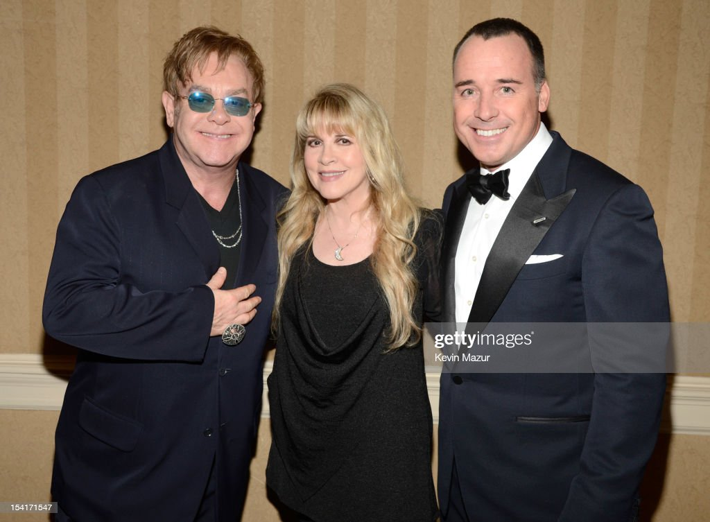 Sir <a gi-track='captionPersonalityLinkClicked' href=/galleries/search?phrase=Elton+John&family=editorial&specificpeople=171369 ng-click='$event.stopPropagation()'>Elton John</a>, <a gi-track='captionPersonalityLinkClicked' href=/galleries/search?phrase=Stevie+Nicks&family=editorial&specificpeople=212751 ng-click='$event.stopPropagation()'>Stevie Nicks</a> and <a gi-track='captionPersonalityLinkClicked' href=/galleries/search?phrase=David+Furnish&family=editorial&specificpeople=220203 ng-click='$event.stopPropagation()'>David Furnish</a> attend the <a gi-track='captionPersonalityLinkClicked' href=/galleries/search?phrase=Elton+John&family=editorial&specificpeople=171369 ng-click='$event.stopPropagation()'>Elton John</a> AIDS Foundation's 11th Annual An Enduring Vision Benefit at Cipriani Wall Street on October 15, 2012 in New York City.