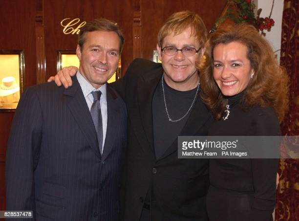 Sir Elton John vice presidents of Chopard Caroline GruosiScheufele and Karl Friedrich Scheufele during the opening of the new Chopard boutique in...