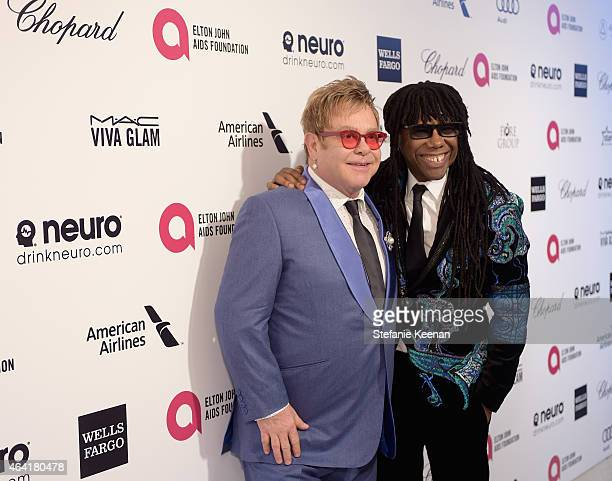 Sir Elton John wearing Chopard and musician Nile Rodgers attend the 23rd Annual Elton John AIDS Foundation Academy Awards viewing party with Chopard...