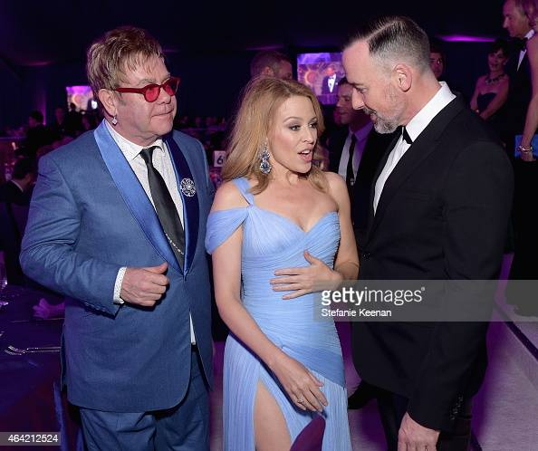 Sir Elton John wearing Chopard singer Kylie Minogue and David Furnish wearing Chopard attend the 23rd Annual Elton John AIDS Foundation Academy...