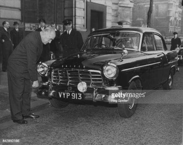 Sir Eric Harrison the Australian High Commissioner in London inspects the first of five 1958 Holden sedan cars to arrive at Australia House in London...