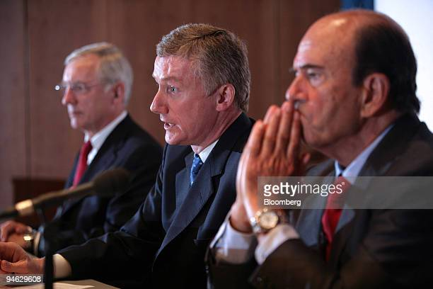 Sir Fred Goodwin centre group chief executive of Royal Bank of Scotland Group Plc speaks at a news conference with JeanPaul Votron left chief...
