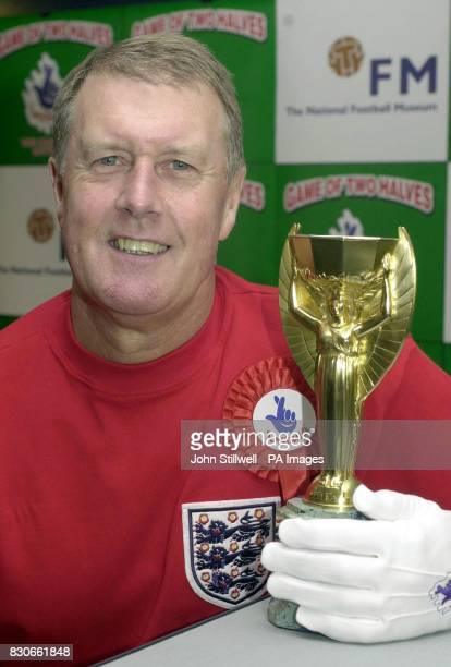 Sir Geoff Hurst the hattrick scoring hero of the 1966 World Cup final with a replica trophy at the launch of the National Lottery Instants...