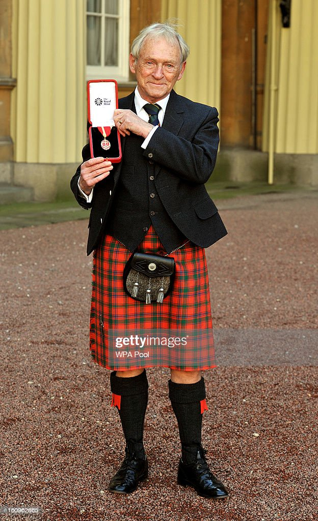 Sir George Reid the Scottish politician proudly holds his insignia of Knight Bachelor, after it was presented to him by the Prince of Wales at an Investiture Ceremony, in Buckingham Palace on February 8, 2013 in London, England.