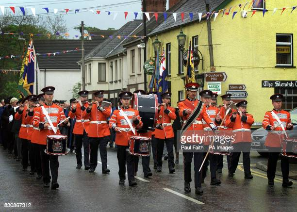 Sir George White Memorial Band lead a parade through the village of Broughshane in Co Antrim Northern Ireland The village is hosting a number of...