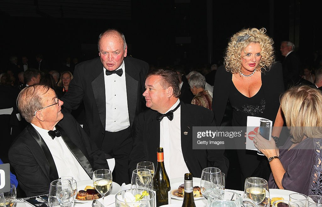 Sir Graham Henry and Trelise Cooper (R) mingle during the launch of the New Zealand Olympic Team uniform at the Prime Minister's Olympic Gala Dinner at the Viaduct Events centre on June 28, 2012 in Auckland, New Zealand.