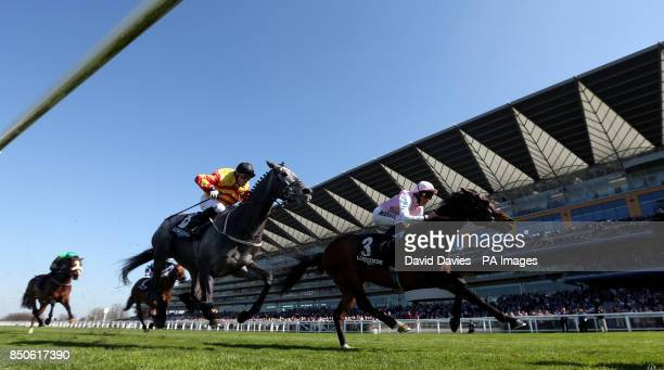 Sir Graham Wade ridden by Kieren Fallon and Caucus ridden by William Buick in the Longines Sagaro Stakes during the Free Raceday at Ascot Racecourse...