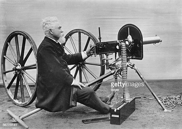 Sir Hiram Stevens Maxim inventor and British industrialist of American origin with a machine gun of his invention BOY 6986