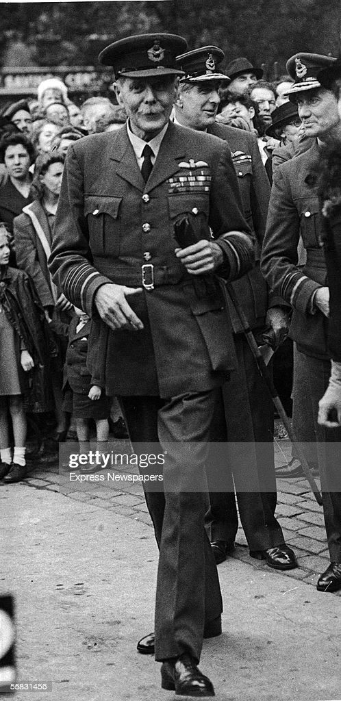 Sir Hugh Montague Trenchard (1873 - 1956), Chief of the British Air Staff during World War I, walking with a crowd and other officers behind him, 1910s. Major-General Trenchard, who was instrumental in establishing the Royal Air Force, is recognized today as one of the first advocates of military strategic bombing.