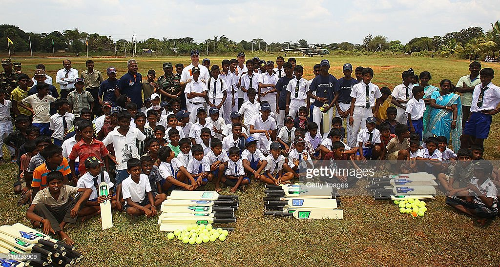 Sir Ian Botham and Michael Vaughan pictured with local school children during a visit to the site for a North Development Project in the town of...