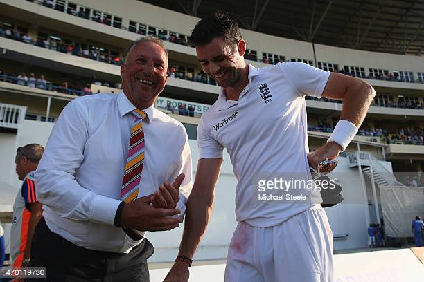 Sir Ian Botham congratulates James Anderson of England after surpassing his record of 383 Test wickets and becoming England's highest Test wicket...