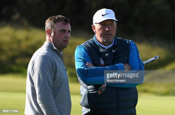 Sir Ian Botham stands with Ian Bishop on the 10th during day two of the 2017 Alfred Dunhill Championship at Kingsbarns on October 6 2017 in St...