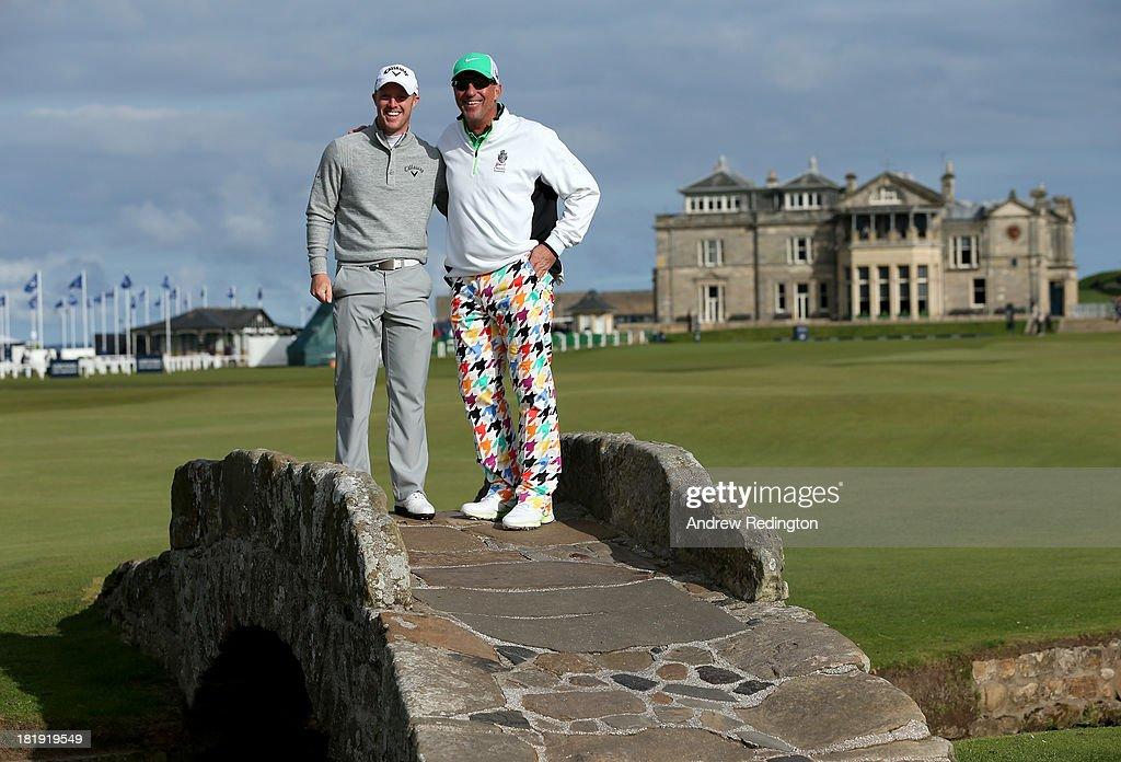Sir Ian Botham with his playing partner David Horsey pose for a photograph on the Swilken Bridge on the 18th hole during the first round of the Alfred Dunhill Links Championship on The Old Course, at St Andrews on September 26, 2013 in St Andrews, Scotland.
