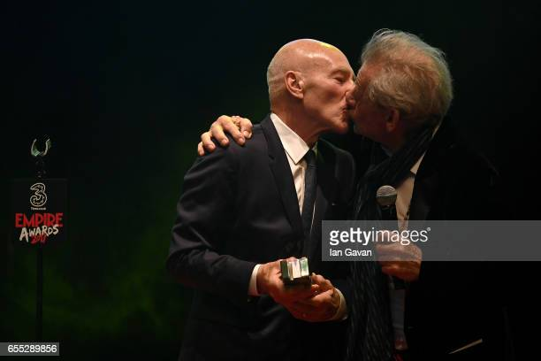 Sir Ian McKellen kisses Sir Patrick Stewart as he presents the award for Empire Legend to Stewart during the THREE Empire awards at The Roundhouse on...