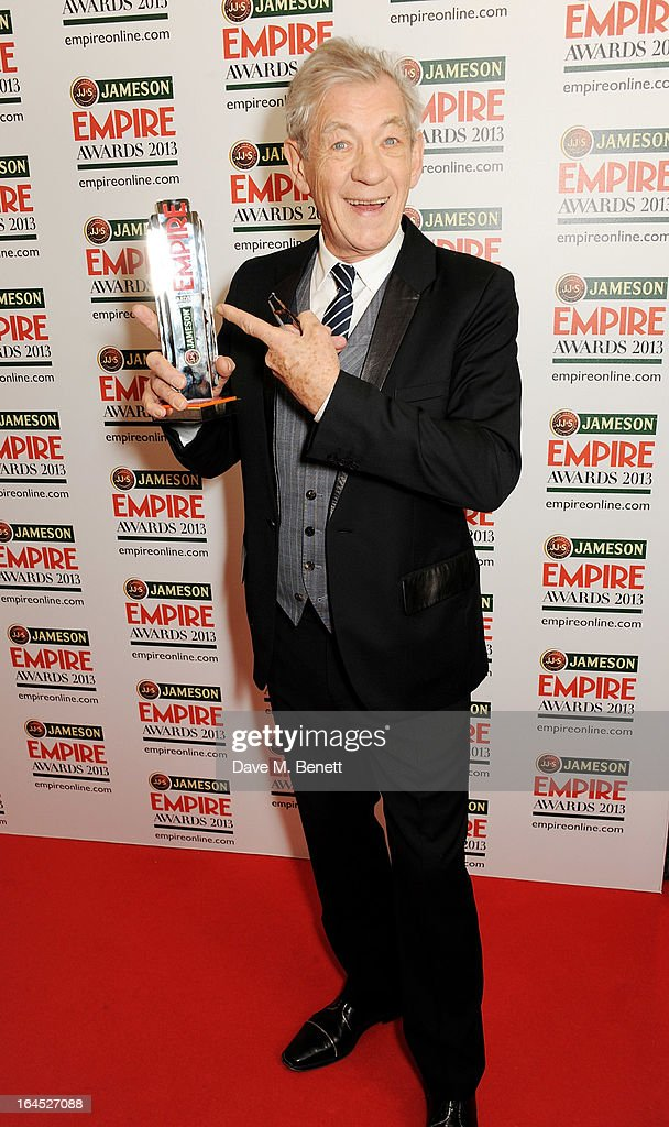 Sir Ian McKellen poses in the press room with the Best Science Fiction/Fantasy award for 'The Hobbit' at the Jameson Empire Awards 2013 at The Grosvenor House Hotel on March 24, 2013 in London, England.