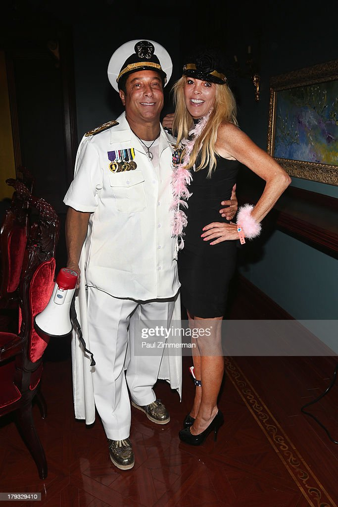 Sir Ivan and <a gi-track='captionPersonalityLinkClicked' href=/galleries/search?phrase=Dina+Lohan&family=editorial&specificpeople=594100 ng-click='$event.stopPropagation()'>Dina Lohan</a> attend Sir Ivan's Sailors and Sinners Soiree on September 1, 2013 in Water Mill, New York.