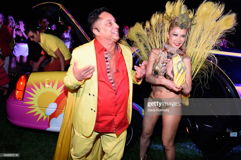 Sir Ivan (L) and Mina Otsuka attend Sir Ivan's celebration of his new hit single 'Here Comes the Sun' at his castle in the Hamptons on August 23, 2014 in Water Mill, New York.