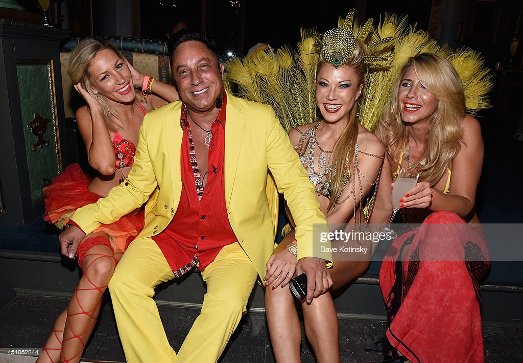 Sir Ivan (2nd L) and Mina Otsuka (2nd R) attend Sir Ivan's celebration of his new hit single 'Here Comes the Sun' at his castle in the Hamptons on August 23, 2014 in Water Mill, New York.
