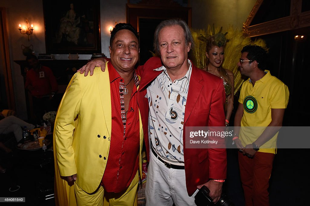 Sir Ivan (L) and Patrick McMullan attend Sir Ivan's celebration of his new hit single 'Here Comes the Sun' at his castle in the Hamptons on August 23, 2014 in Water Mill, New York.