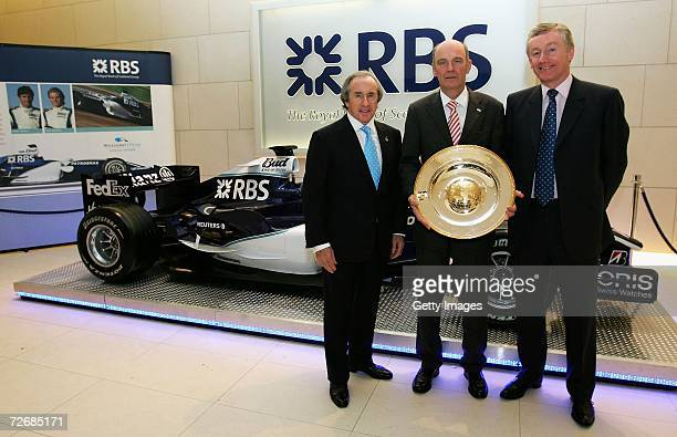 Sir Jackie Stewart poses with Dr Wolfgang Ullrich after he was awarded the The Jackie Stewart Award for 'Outstanding Acheivement' Sir Fred Goodwin...
