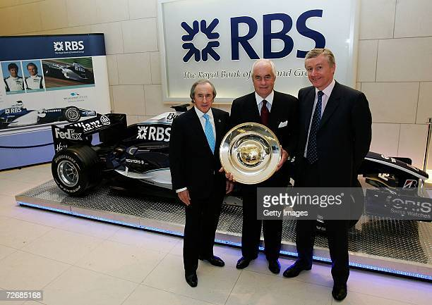 Sir Jackie Stewart poses with Roger Penske with The RBS Award for 'Outstanding Acheivement' and Sir Fred Goodwin during the RBS Award Presentation at...