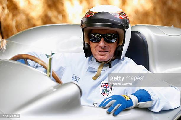 Sir Jackie Stewart prepares to drive up the hill at Goodwood on June 27 2015 in Chichester England