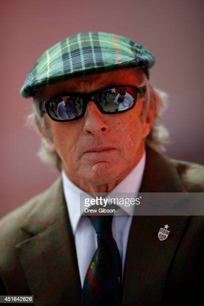 Sir Jackie Stewart speaks to members of the media in the paddock during previews ahead of the British Formula One Grand Prix at Silverstone Circuit...