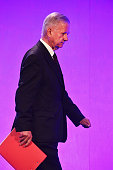 Sir John Chilcot leaves the stage after presenting The Iraq Inquiry Report at the Queen Elizabeth II Centre in Westminster on July 6 2016 in London...