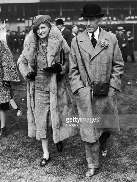 Sir John Henry 'Jock' Delves Broughton the 11th Baronet of Doddington and Lady Delves Broughton attend the first day of the Chester races 2nd May 1939
