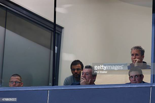Sir John Kirwan and the Blues coaching staff watch the game during the round 18 Super Rugby match between the Blues and the Highlanders at Eden Park...