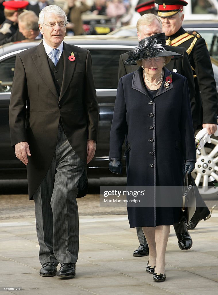 Sir John Major and Baroness Margaret Thatcher attend the Armistice Day service at Westminster Abbey on November 11 2009 in London England The service...