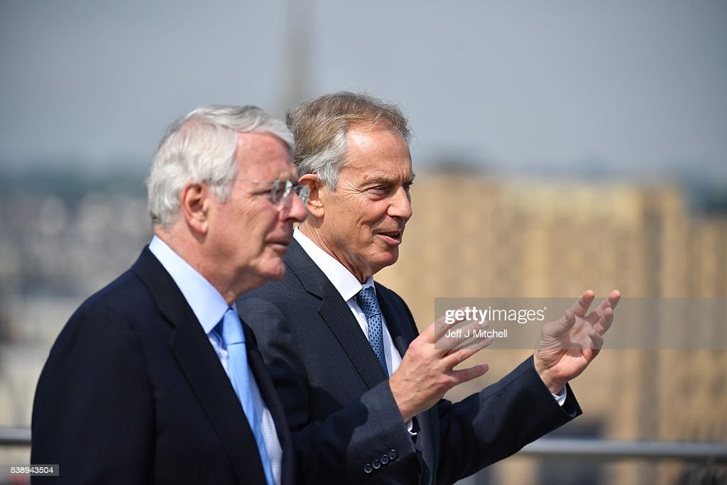 Sir John Major and Tony Blair speak as they walk across the Peace Bridge on June 9 2016 in Derry Northern Ireland Former Prime Ministers Sir John...