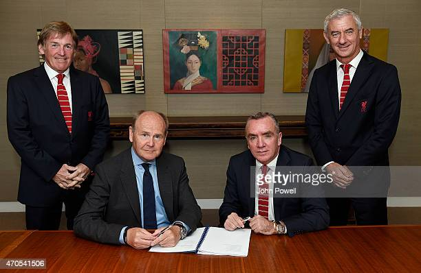 Sir John Peace Chairman of Standard Chartered and Ian Ayre Chief Executive of Liverpool Football Club pose next to Kenny Dalglish Non Executive...