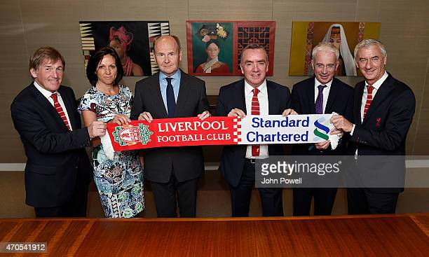 Sir John Peace Chairman of Standard Chartered and Ian Ayre Chief Executive of Liverpool Football Club pose with Kenny Dalglish Non Executive Director...