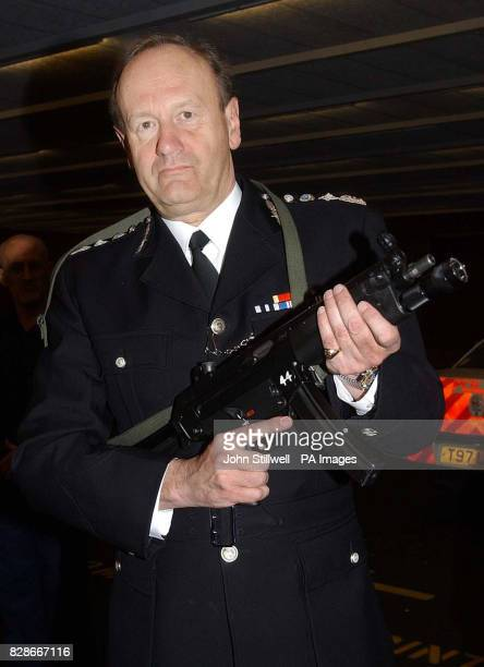 Sir John Stevens the Commissioner of the Metropolitan Police holds a Heckler Koch MP5 machine gun during a visit to the force's new 55million...
