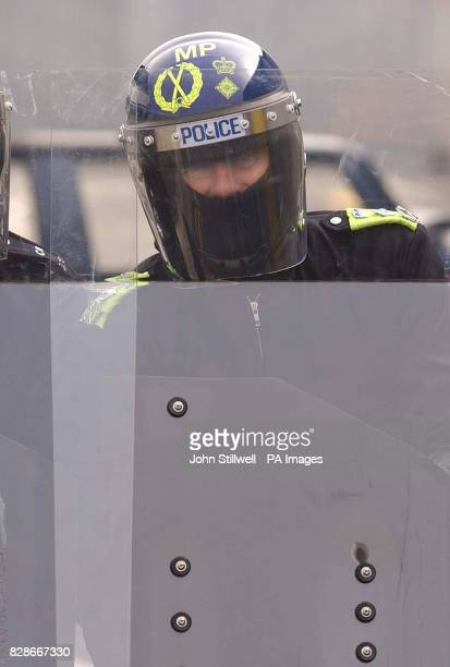 Sir John Stevens the Commissioner of the Metropolitan Police holds a riot shield during a visit to the force's new 55million stateoftheart firearms...