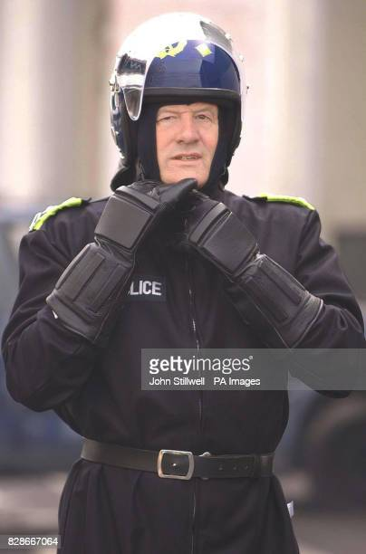Sir John Stevens the Commissioner of the Metropolitan Police wears a riot suit during a visit to the force's new 55million stateoftheart firearms and...