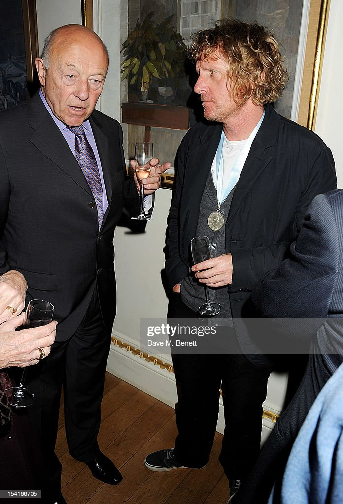 Sir John Tusa (L) and Grayson Perry attend as Charles Saumarez Smith, Chief Executive of the Royal Academy of Arts, launches his new book 'The Company Of Artists: The Origins Of The Royal Academy Of Arts In London' at The Royal Academy of Arts on October 15, 2012 in London, England.